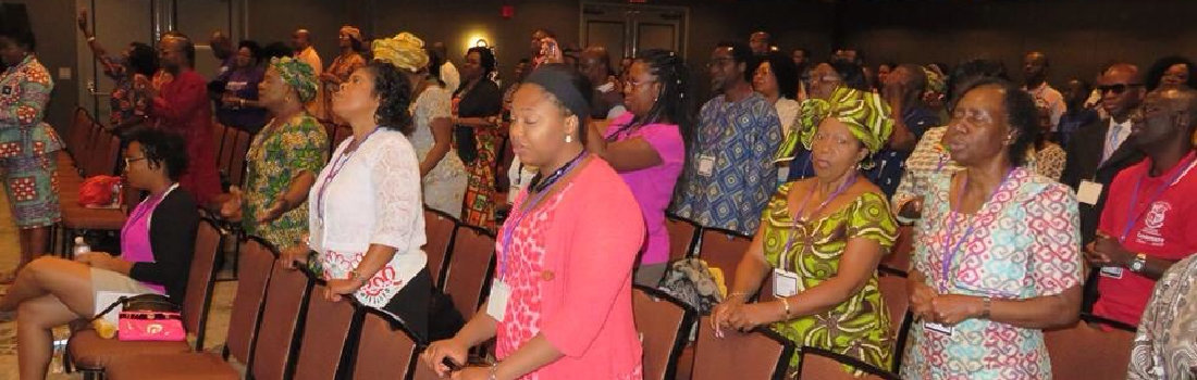 A group of african american praying