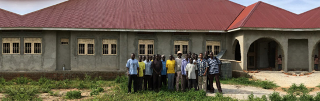 group of people standing in front of a house